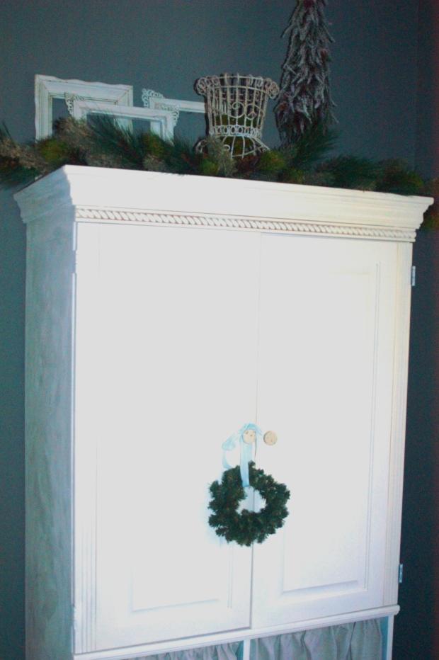 Hang miniature wreaths from pretty, velvet ribbon.